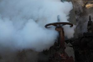 Image shows steam leaking from valve. Steam carries heat energy and steam leaks are a waste of this energy. Imperia Engineering Partners & ReWire Energy can help reduce energy waste and maximize energy value in residential, commercial, industrial, institutional, and governmental facilities.