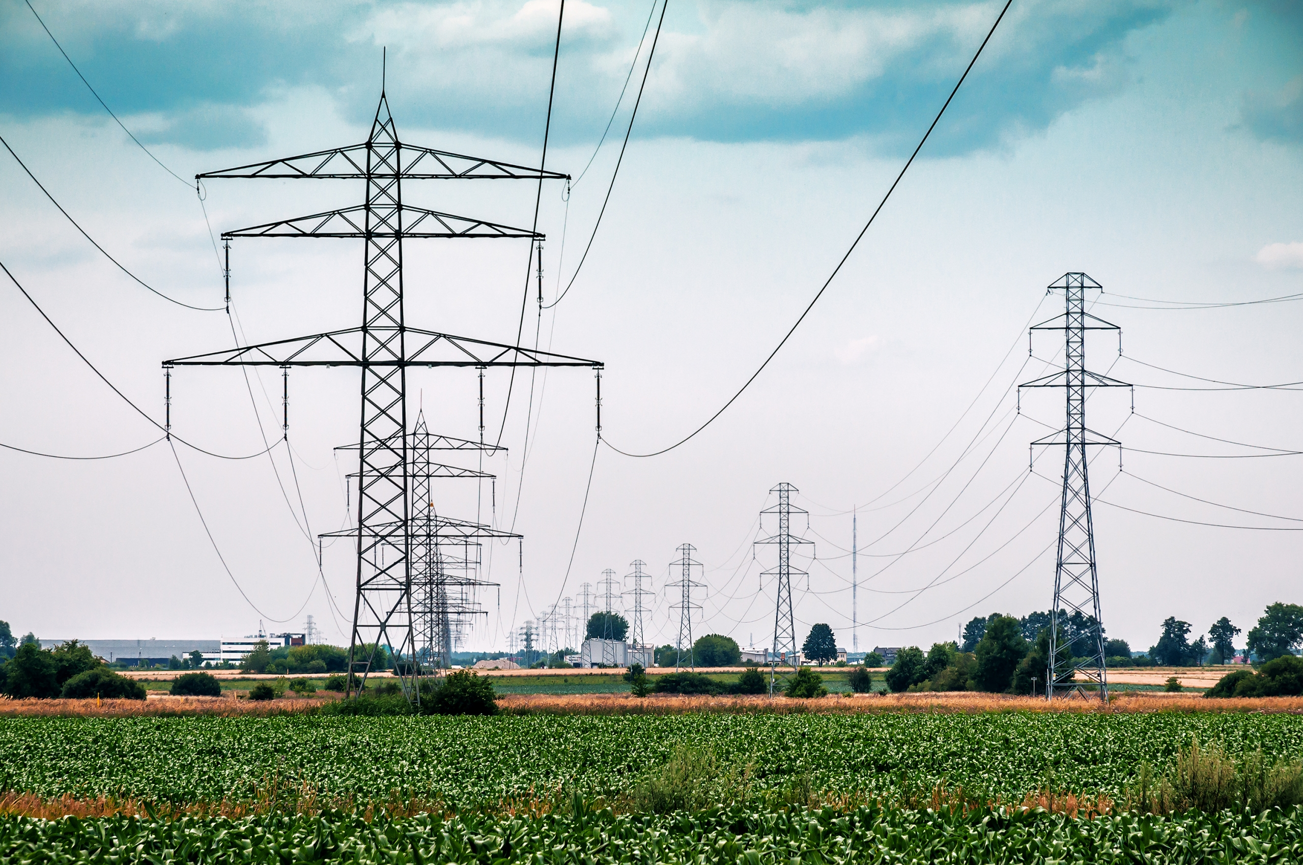 Electrical transmission towers and lines show the air surrounding the lines into which heat energy dissipates.