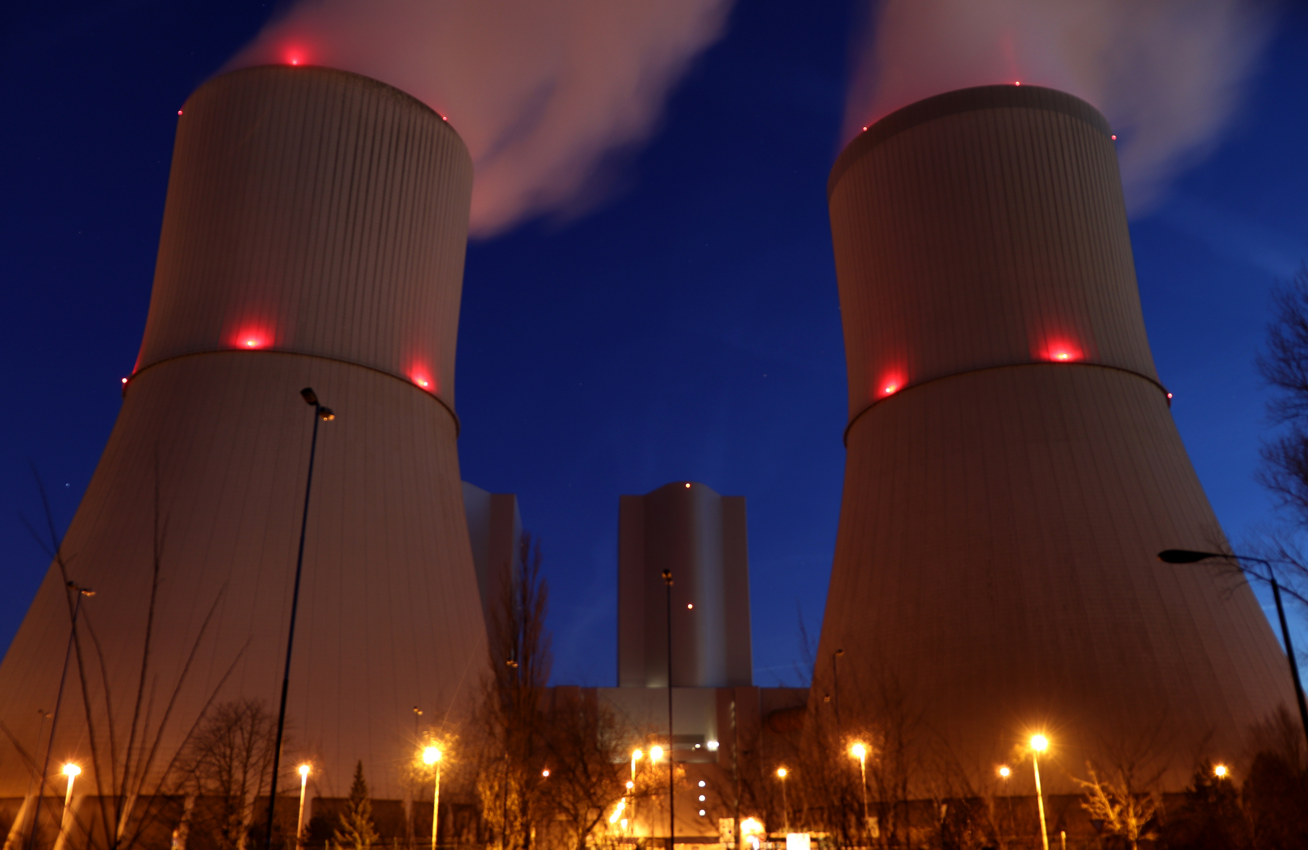 This image of nuclear power plant cooling towers at night complements the text of the articles which tells of Imperia Engineering performing code reconciliation on the piping of a nuclear plant's Flow Accelerated Corrosion (FAC) program resulting in significant cost saving to the plant.